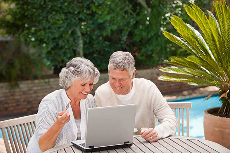 SeniorNet Couple With laptop